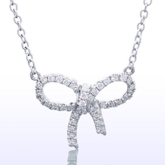 dainty diamond bow necklace. Black Bedroom Furniture Sets. Home Design Ideas