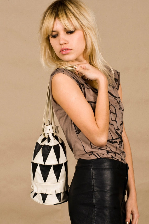 black and white leather bag with triangle tribal pattern