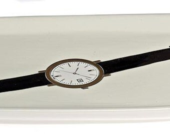 ceramic watch tray in ivory 22kt gold on watch
