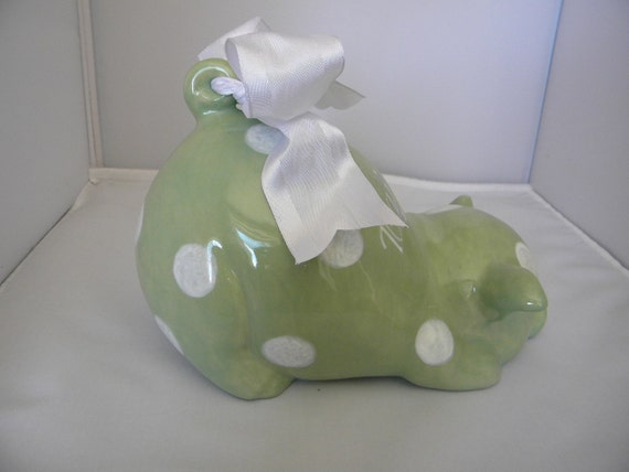large green with white polka dots piggy bank