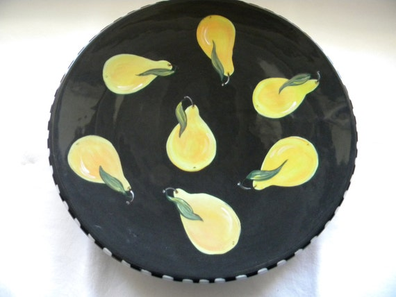large round serving platter, black with pears