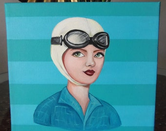 Vintage aviation girl with goggles on a teal striped background