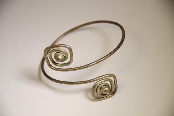Silver spiral arm band