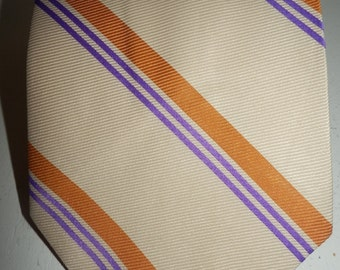 1960s or 1970s brown purple necktie by Prince Consort with a Golden clasp