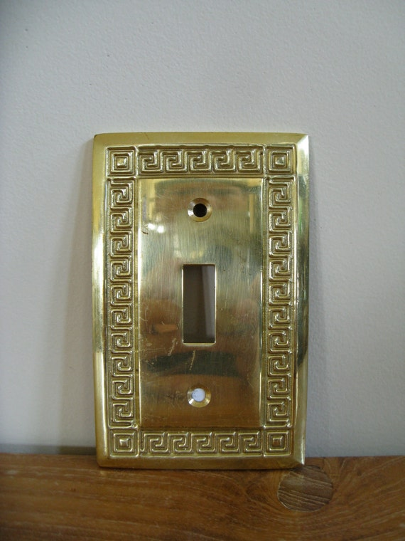 Solid brass switch plate with Greek key border