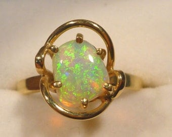 Ladies Opal Ring 14ct Yellow Gold  Claw Set Free Form Solid Opal. item 30099.