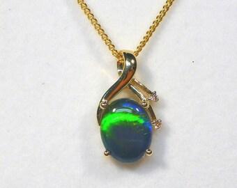 Opal & Diamond 14ct Yellow Gold Pendant.10 x 8 mm Oval Triplet Opal. item 30583.