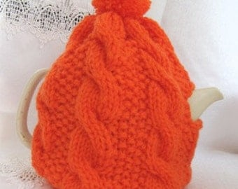 Tea Cosy,  Orange teapot cozy, cable design, knitted with pompon