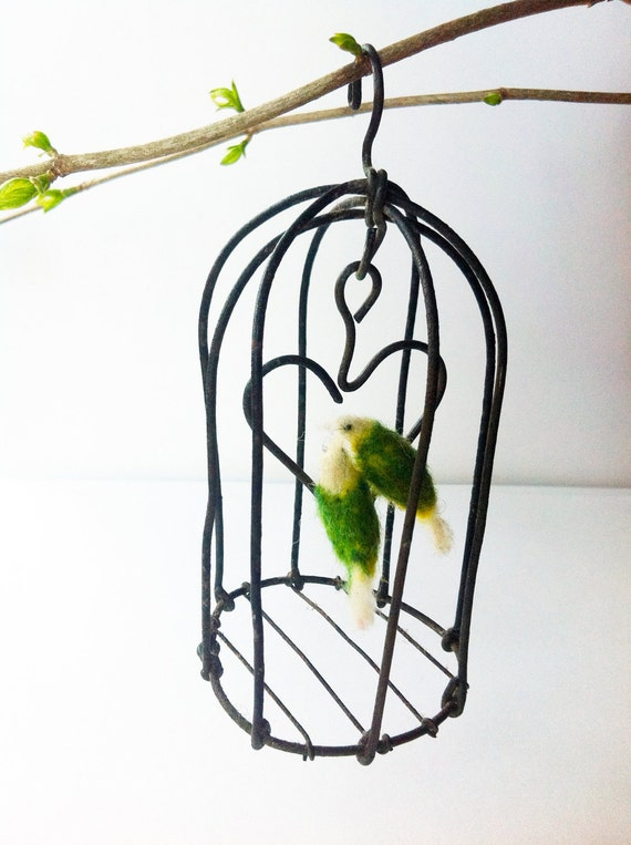 felted lovebirds sits in an antique mini birdcage