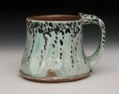 black spotted blue green terra cotta mug