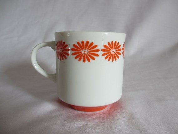 Adorable little vintage mug with orange daisies
