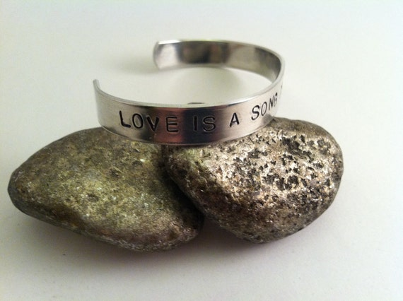 """Bambi """"Love is a Song that Never Ends"""" Bracelet."""