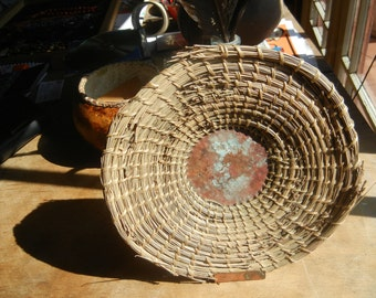 Hand woven coiled pine needle fine art basket with a copper center and red and green patina