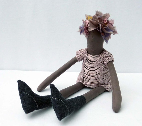 Knitted and fabric doll in her ladder handknitted dress