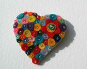 Multicolourful heart shape felt brooch with seed beads and a red flower