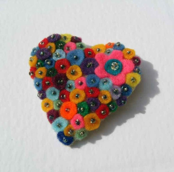 Multicolorful heart shape felt brooch with seed beads and a pink flower