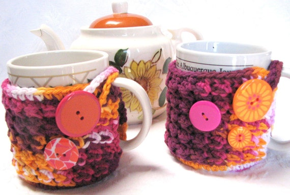Matching pair of Mug Hug cozies with coaster bottom, crocheted in 100% cotton, decorative buttons