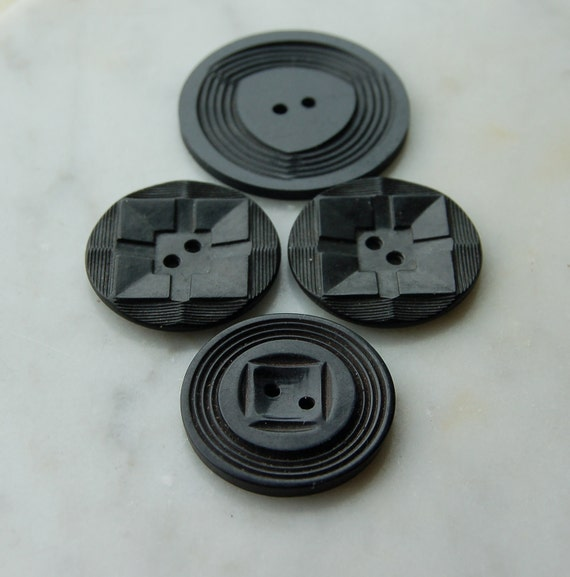 """4 Large Vintage Art Deco Black Plastic Buttons .One pair and 2 singles. largest 1 1/2"""" diameter  2 hole sewing notions"""