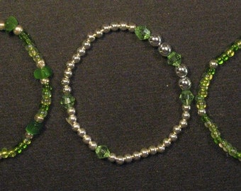 Green and White Faux Pearl Bracelet Set.