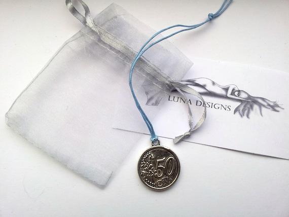 50 cent piece bracelet on waxed cotton cord