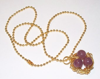 "Beautiful ""I'm Eggstatic"" Gold Tone Wire Handmade Bird's Nest With Purple Bead Eggs"