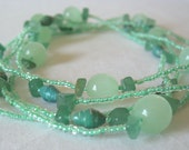Mint green long beaded necklace with recycled paper, jade, and glass