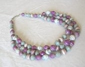 African recycled paper necklace in purple, violet, pale blue, and white