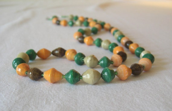 African recycled paper necklace in grass green, orange, chocolate brown, and beige