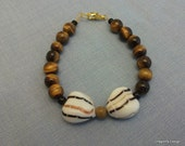 Woman's or teens bracelet, brown tiger eye semi precious beads with 2 white, gold and black Lampwork hearts