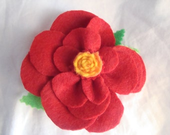 Red and yellow flower clip. Hand made/felt