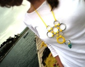 Nickel rings necklace in bright yellow cords