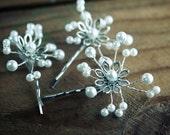 Three white pearl beaded flower hair pins.