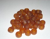 Amber colored pony bead