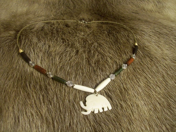 Necklace with bone Mammoth pendant and spiral design