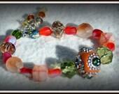 Bracelet: Beaded Coral Glass Bracelet with Detailed Center Bead