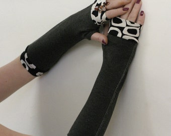 Black fingerless gloves with black and white cuffs