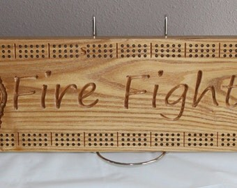 Fire Fighter cribbage board with 3D Maltese cross made from Black Ash