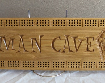 Man Cave cribbage board with 3d carved beer mugs made from Black Ash