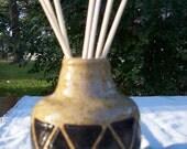 Small stoneware vase or scented oil diffuser