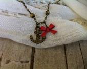 Anchors Away. With Red Bow. Antique bronze/brass anchor charm bracelet