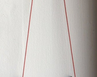 The Della Eyeglass Chain in red with silver ends