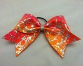 """3"""", 3 inch cheer cheerleader bow silver squiggle lines throughout pink and orange tie dye"""