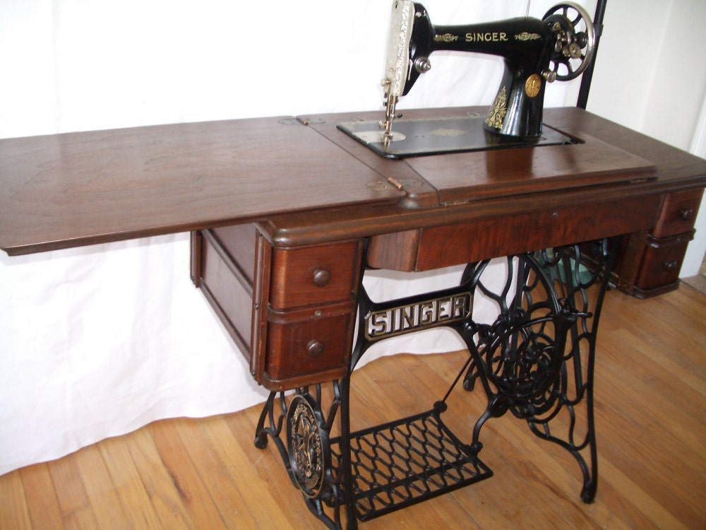 Singer 66 Treadle Sewing Machine In Walnut Cabinet