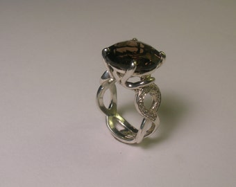 Smoky Quarts Set In Sterling Silver With Accent Diamods