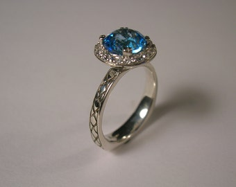 Sterling Silver Swiss Blue Topaz Ring With Accent Stones.