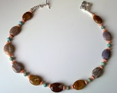 Understated PETRIFIED WOOD turquoise and coral choker