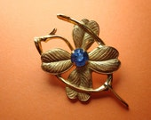 50s Goldtone, Coro wishbone and four-leaf clover luck pin with sapphire-blue rhinestone