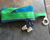 Keyring Earbud Headphone Case by Dapper Apologist - cerulean blue, kelly green, grey/purple