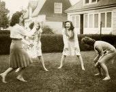Four girls playing in the garden. Sanpshot 1940