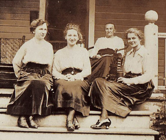 Three young women with Grandma on the porch. Old snapshot. C. 1890